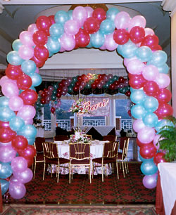Balloon Arch and Name Sign behind Disc Jockeys
